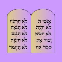 2 pierres avec des commandements écrits dessus